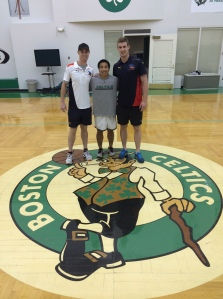 Centre Court: Tom and I stand in the middle of the Boston Celtics training court.