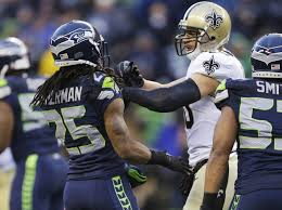 Love-Hate relationship: Former rivals now team mates Richard Sherman and new Seahawk Jimmy Graham.