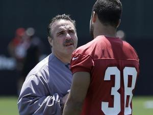 Hayne chats with new head coach Jim Tomsula
